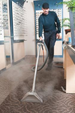 Steam Master Carpet & Upholstery Cleaning Inc cleaning carpet via hot water extraction in Candler NC.